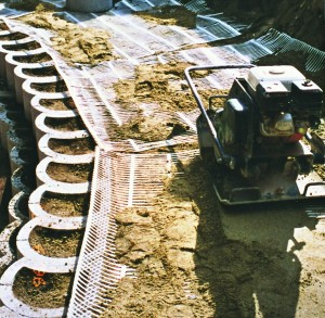 geogrid-geofabric on compacted backfill