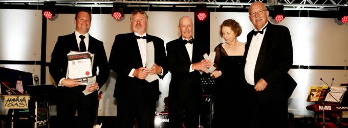 Cape Retaining System receiving a CMA Awards Trophy