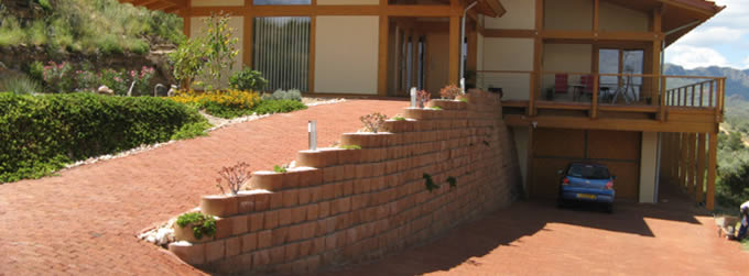 Drive way support and erosion control with a Terraforce retaining wall