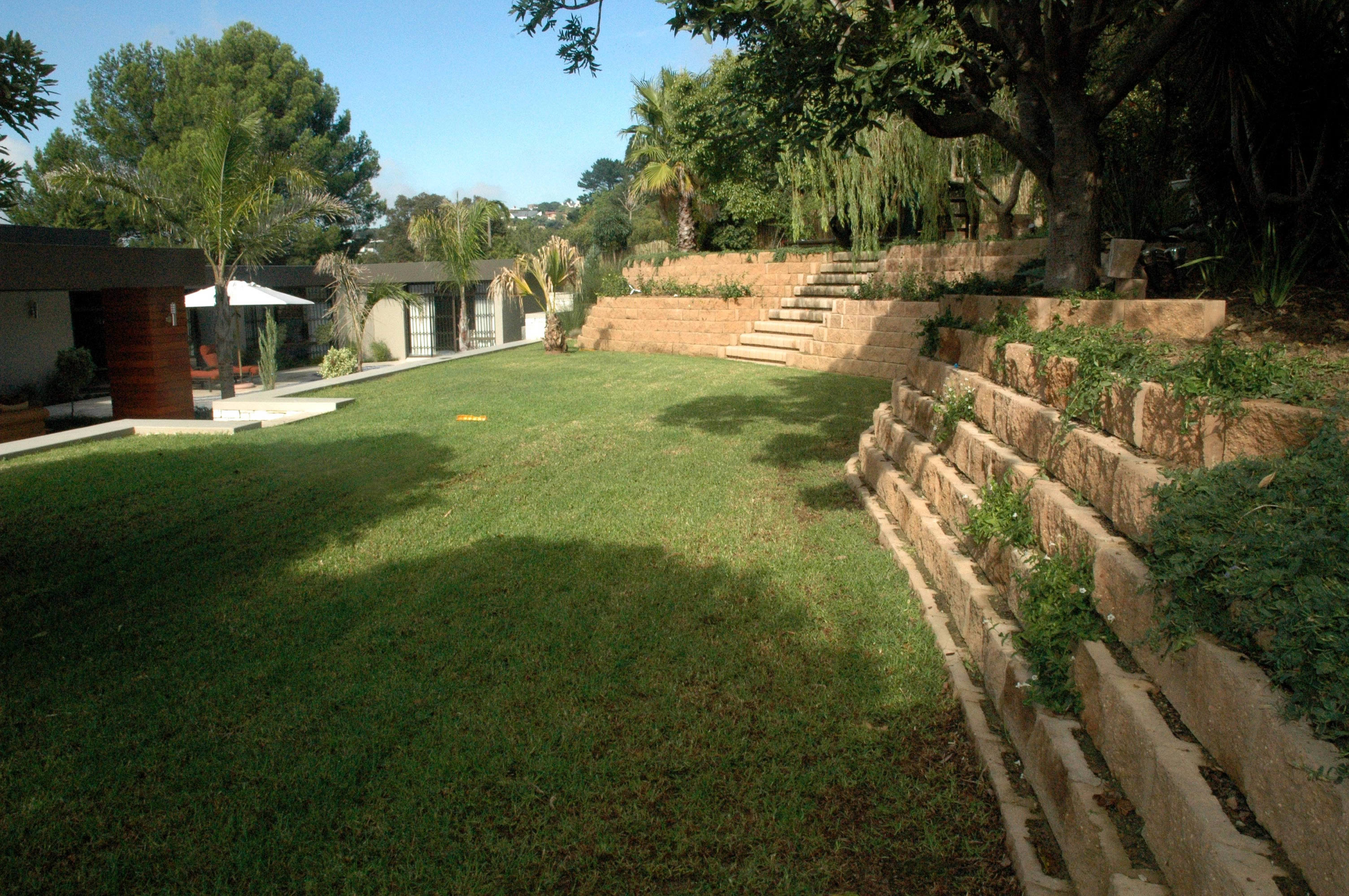 Landscape Blocks On A Slope : Steep slope transformed into a spacious garden terraforce