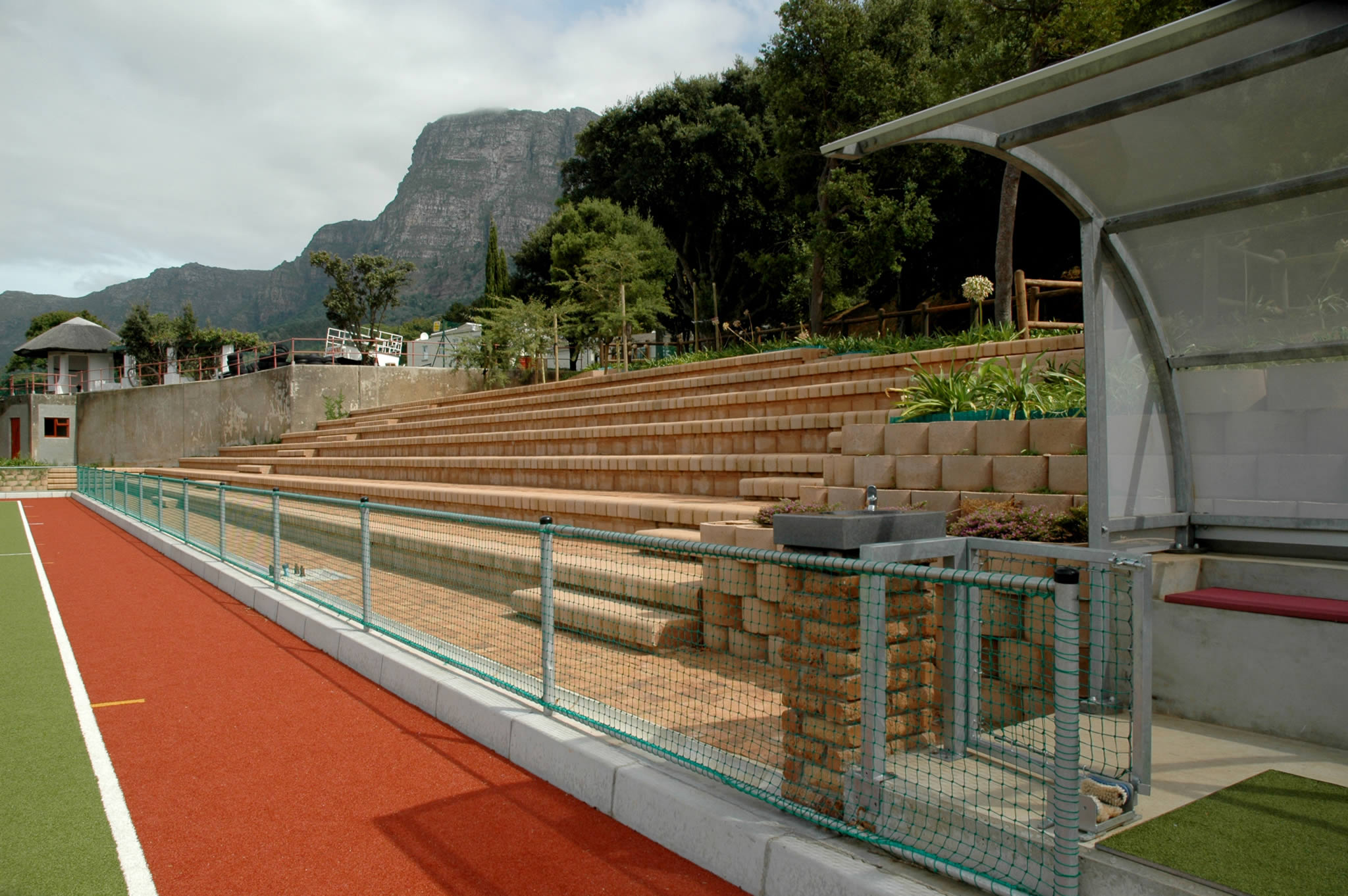 Step block retaining wall system creates seating for school