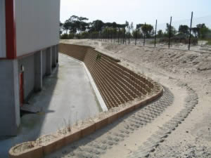 Retaining walls and storm water channels around two boundaries