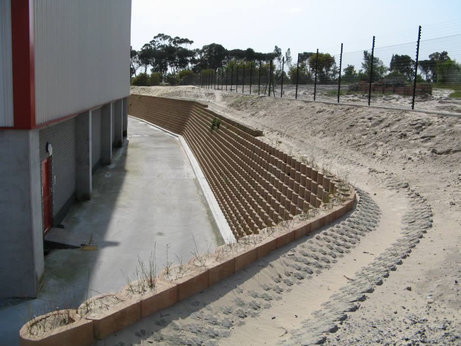 Water Retaining Walls : Retaining walls and storm water channels around two