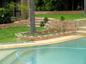 Hard landscaping shaped around existing features