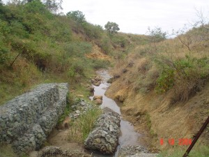 Badly eroded stream bed and sides