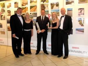 Jeremy Leighton, SP van Blerk and Holger Rust receiving the Award