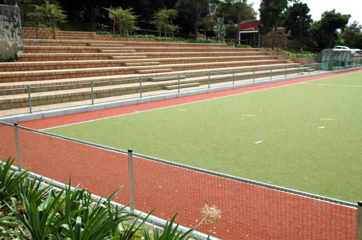 Astro Turf Hockey Pitch with seating and retaining walls