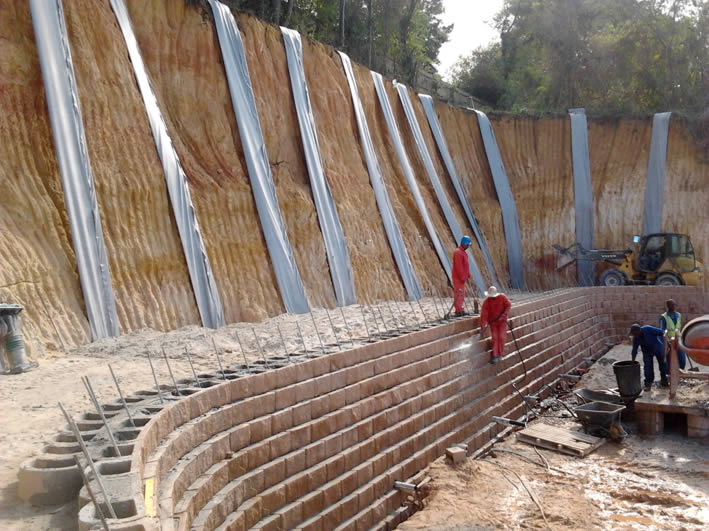 The wall is backfilled with a 3m wide layer of cement stabilised sand which was further strengthened with layers of geo-grid
