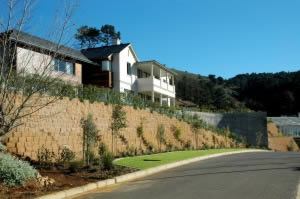 The segmental block retaining wall  runs along the top and the bottom of the property.