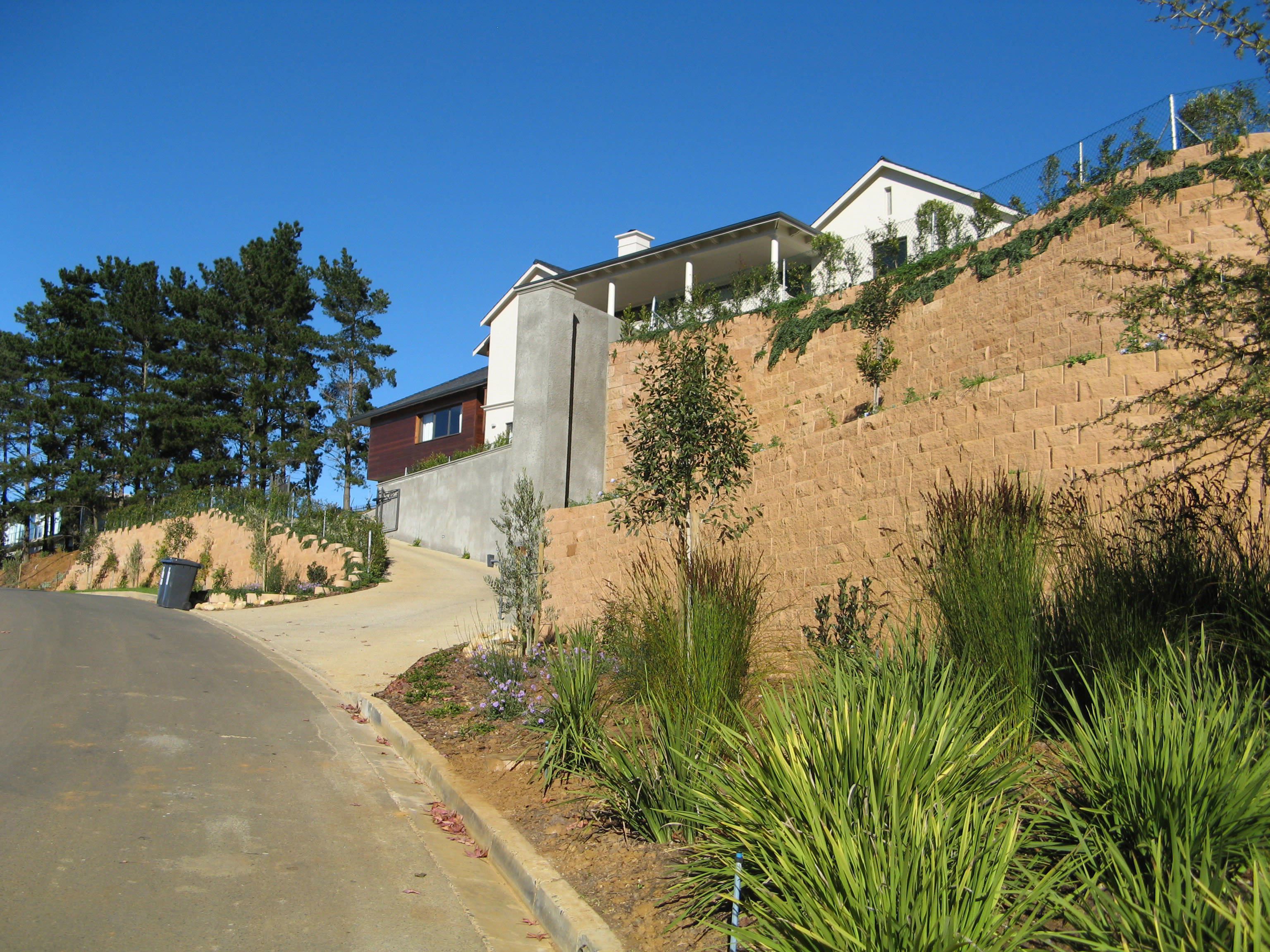 retaining wall to prevent soil erosion, here seen along the drive way