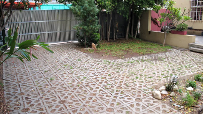 Permeable grass pavers can add a park-like or pastoral feel to areas normally needing hard paving.