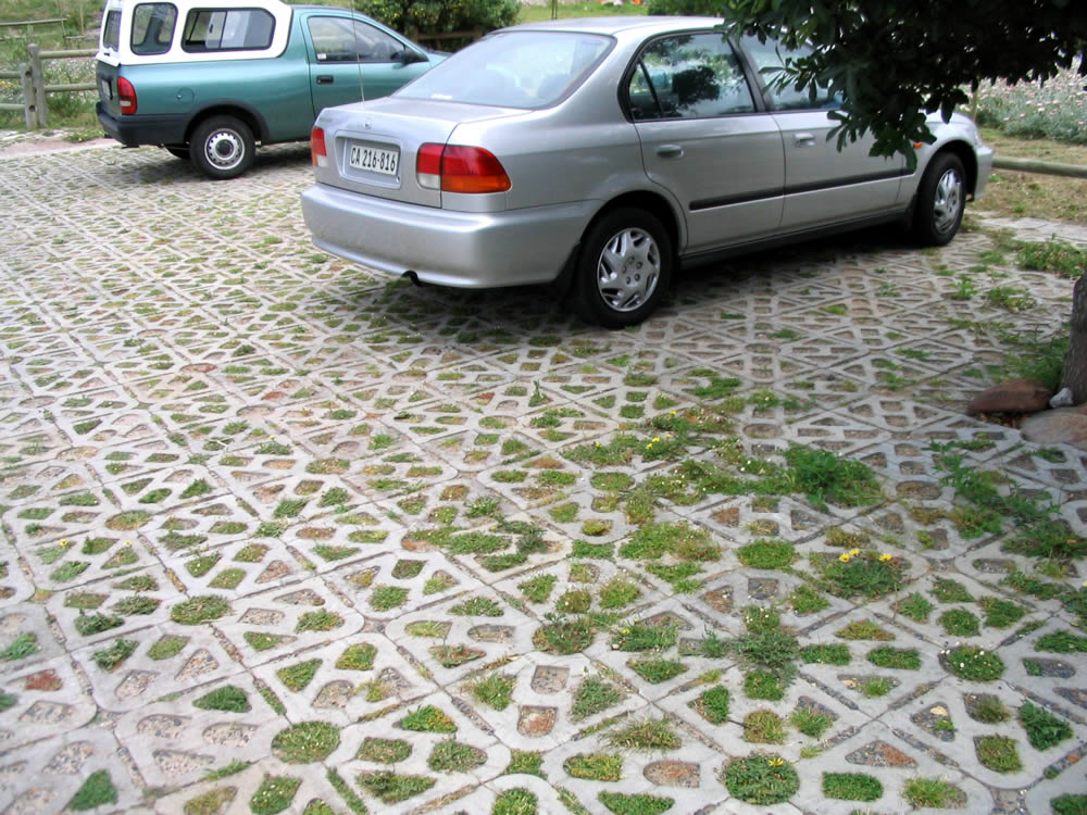 As a finishing touch the pavers can be filled with gravel or planted with hardy grass to create a softer surface