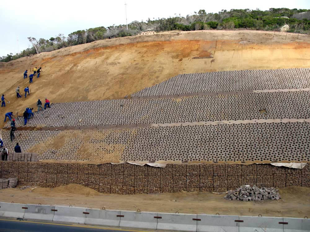 Terrafix blocks being packed onto the prepped slope