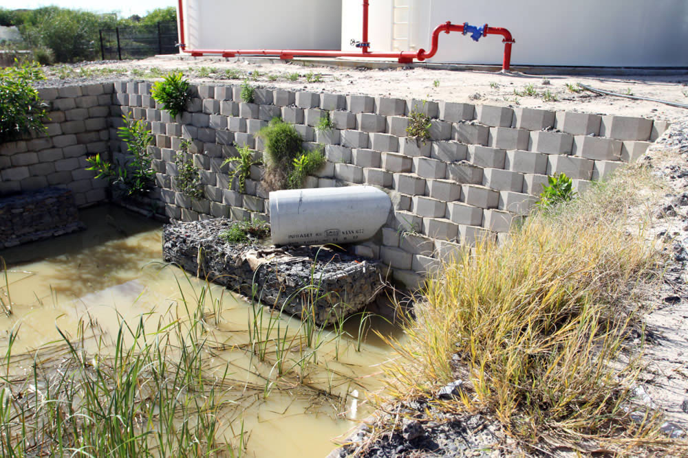 An interlocking, permeable retaining wall system, the new Decorwall block system by Decorton Retaining System