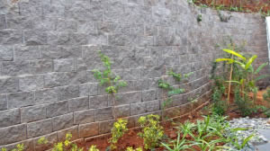 A close-up of the wall, showing the rock-face finish