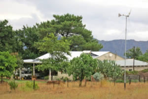 The farm house on Olivia, with wind turbine in the foreground