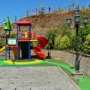 The playground on the terrace created by the retaining wall