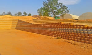 Local backfill, compacted with pedestrian rollers and rammers was used, with geotextile reinforcing at specified levels