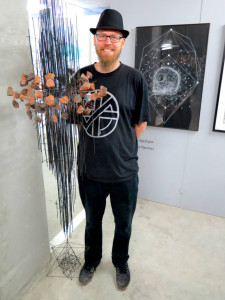 Dirk Bahmann with one of his artworks