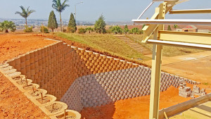 The wall is constructed with a front layer of blocks filled with reinforced concrete and Y12 rebar to the top, backed by a second, unreinforced layer 3m high only