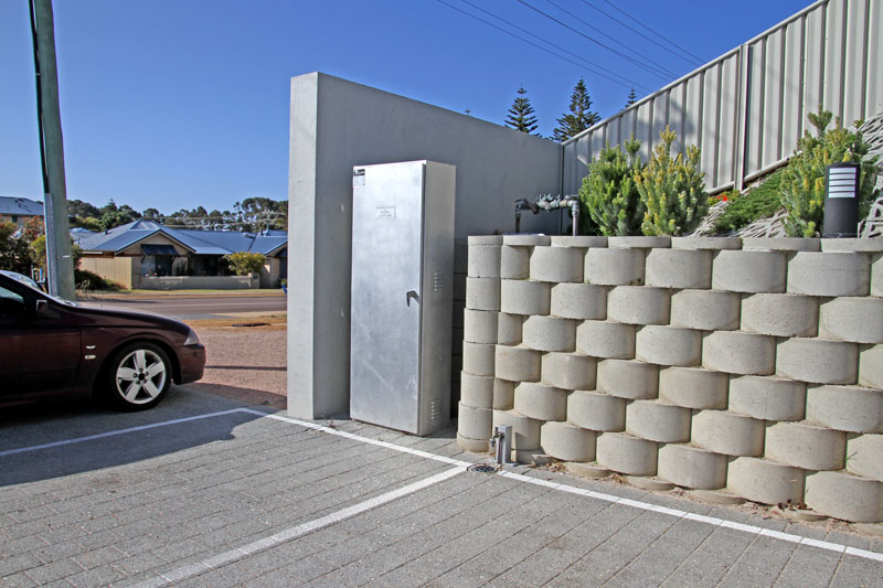 A recess was created to protect an existing utility control box