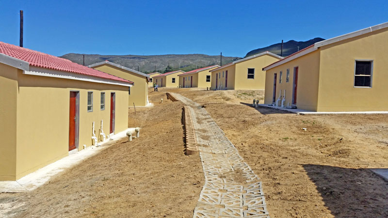Creating building platforms, access steps and road support for low cost housing