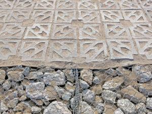Terracrete pavers bordering a gabion break line