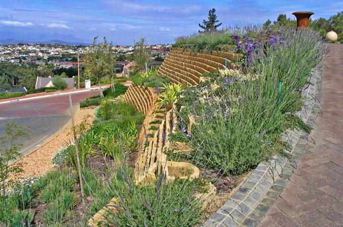 Single skin gravity retaining wall, beautifully planted