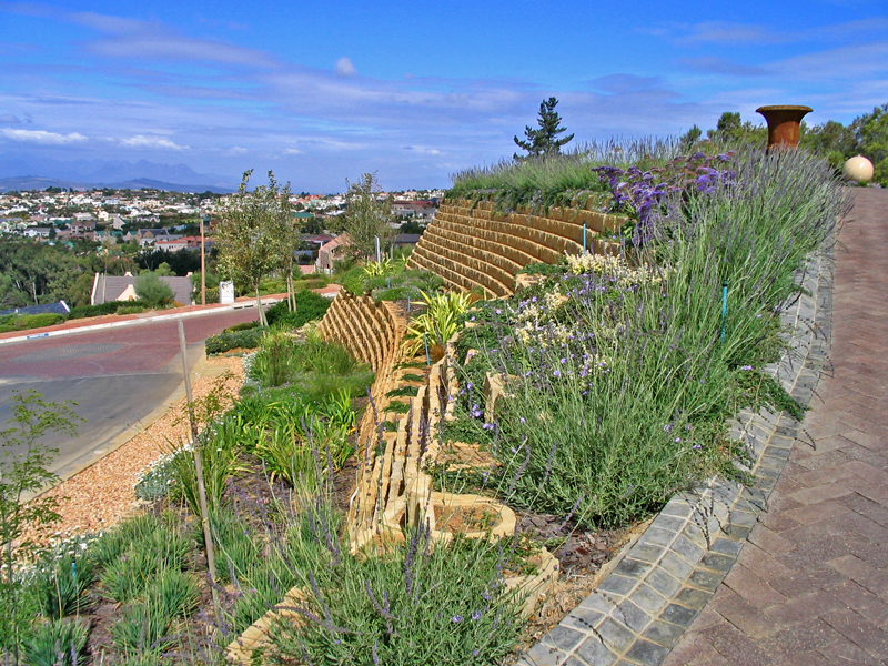 Single skin gravity retaining wall, beautifully planted