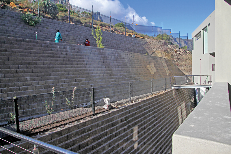 Three terraces behind the luxury complex are retaining with Terraforce