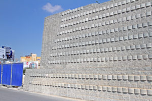 The completed retaining wall acts as noise barrier for the hospital