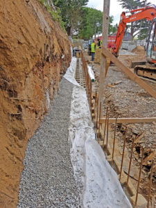 Sub-soil drain encased in no-fines concrete, wrapped in filter fabric