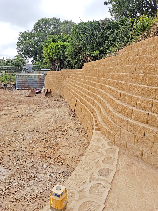 Applying final touches and preparing for landscaping.