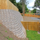 The block is affordable in comparison to other earth retaining solutions, easy to install and transport and in the next season we will be planting some plant cover, which will finish the wall nicely