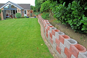 Situated in Sheffield, the small retaining wall stands out with a creative pattern of grey and red rock face L15 blocks