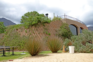 Restaurant in a slope, cladding with Terraforce and planted.