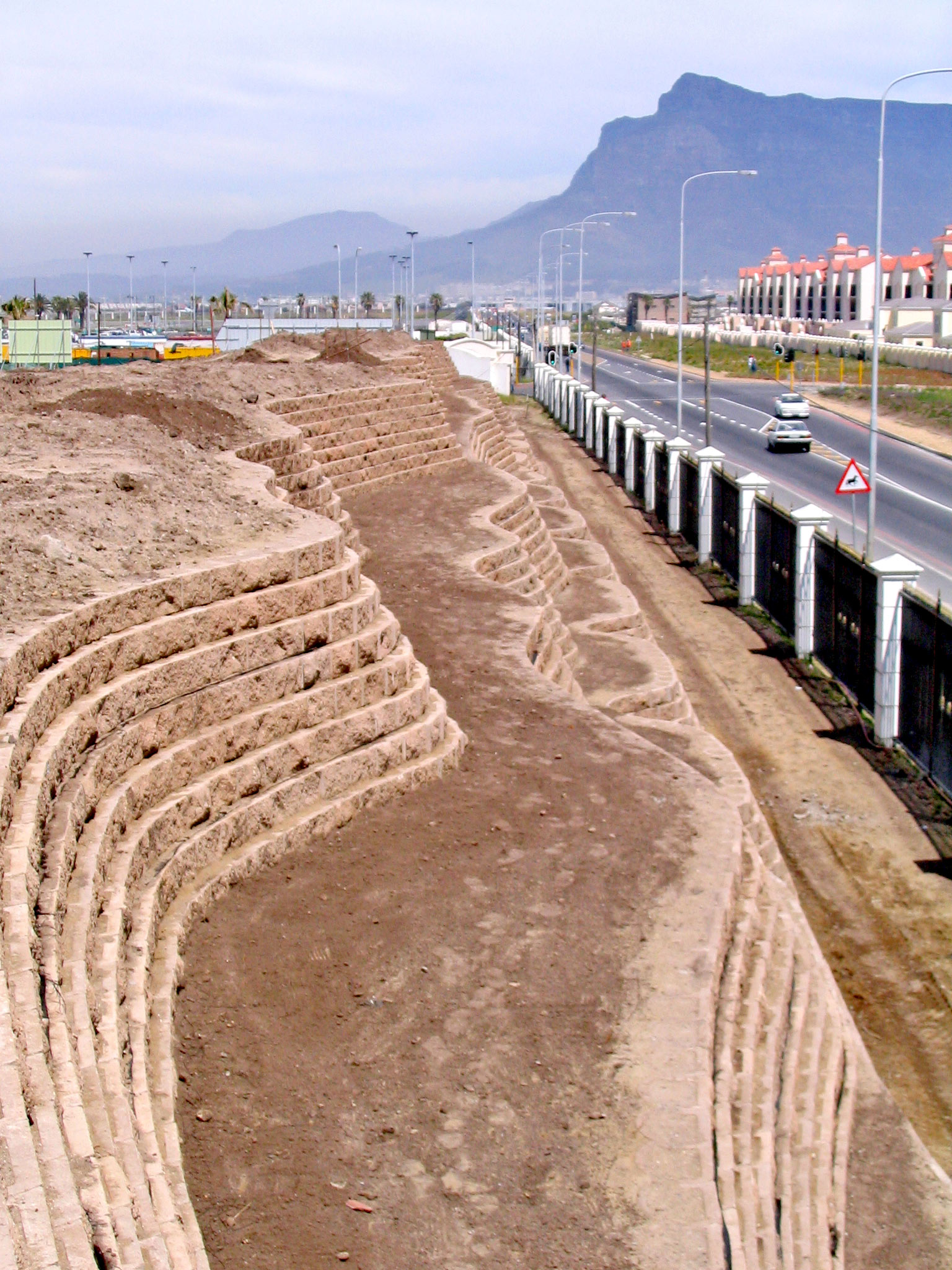 In order to protect future residents from excessive traffic noise from a planned double carriage highway and any possible negative visual impact associated with this, a 4.5 metre high and 500m long earth berm was created with the surplus site material.