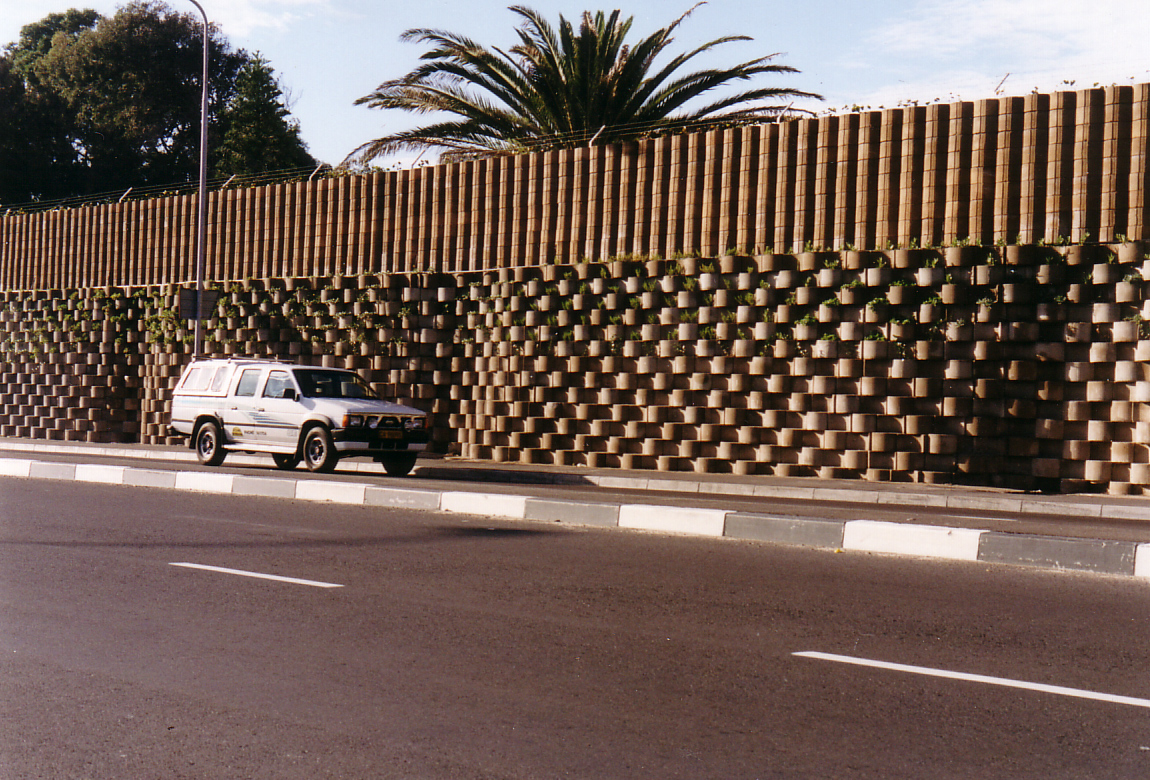 The completed noise barrier, constructed using Terraforce L11 blocks, works by reflecting noise back across Stanhope Road.