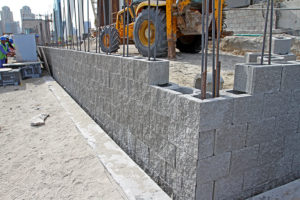 The blocks were installed using steel dowels embedded in the foundations, after which they were filled with concrete