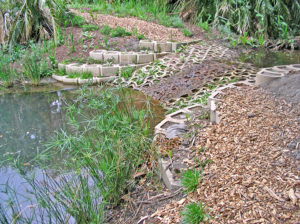 One of the inlets in action, line with the Terrafix erosion control blocks