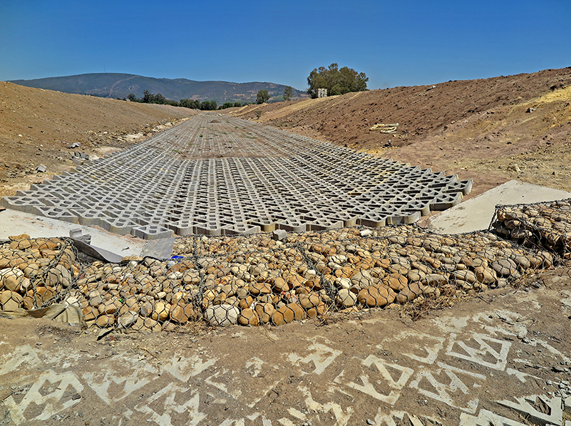 The channel with the Gabion weir just after completion