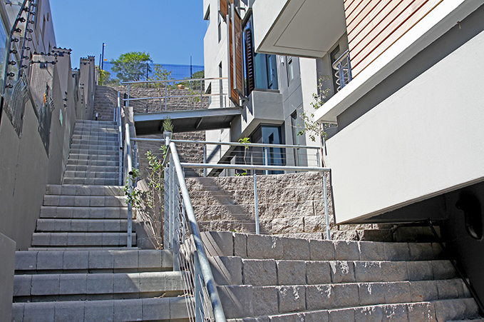 Fire escape staircases on each side of the property were built as part of the retaining wall structures using Terraforce's 4x4 Step blocks.