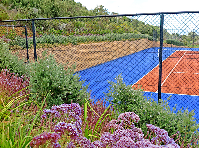 Terraforce retaining wall stabilisng cut slopes next to a tennis court