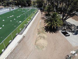 Three exposed fill slopes needed earth retaining walls
