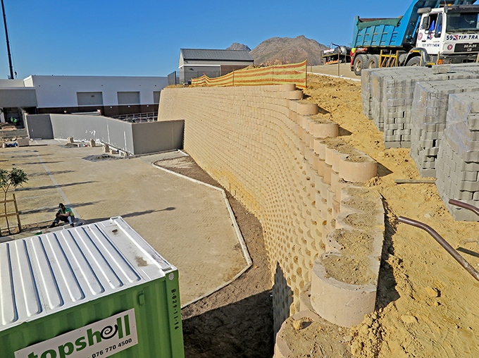 Added reinforcement consists of Findrain 2m c/c, Rockgrid 200/200 as tiebacks and 3% sand/cement stabilized backfill