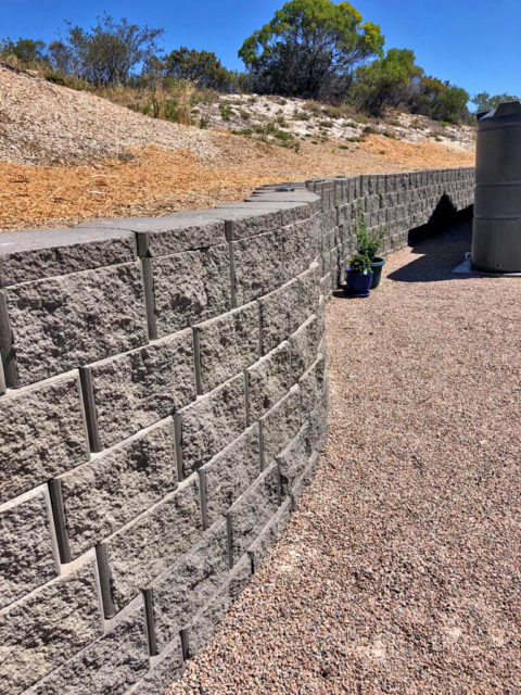 Curved backyard retaining wall