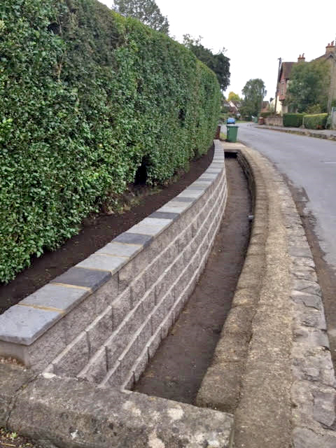 The new, neat ditch wall