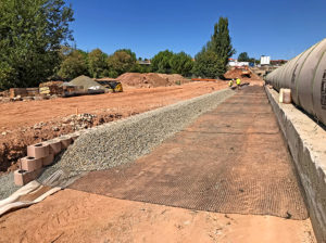 Installation of drainage layer and geogrid reinforcing