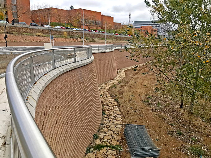 The completed project is pleasing to the eye, and the additional coping blocks, the fencing along the top, as well as the large rock strip lining the base