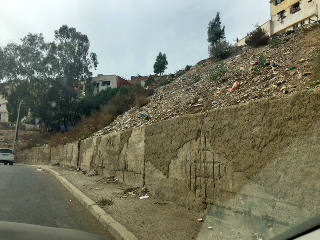 Eroded wall and slope before rehabilitation
